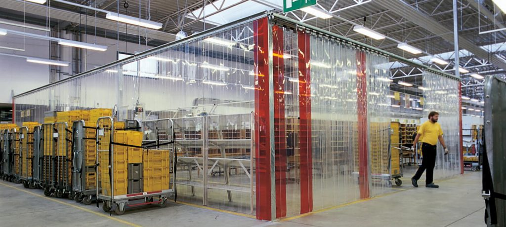 Maxiflex strip curtains manufactured from flexible durable PVC_ variety of colours & formats_ for sealing doorways & creating partitions in industrial & commercial buildings
